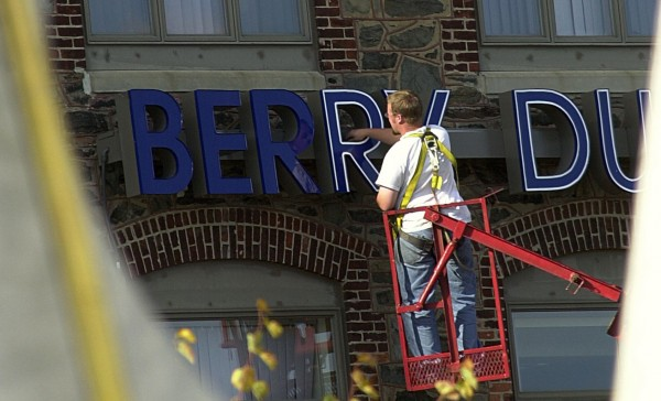 A worker fixes a sign for the accounting firm BerryDunn on the Bangor waterfront in 2001.