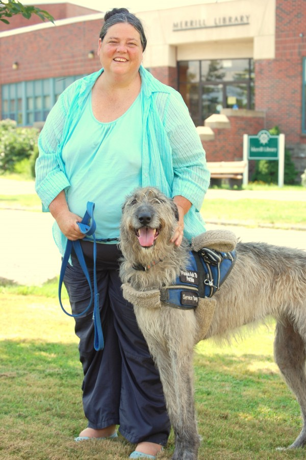 Kathy Hecht relies on the help of an Irish wolfhound to assist her with mobility issues associated with her degenerative back disorder. This fall Hecht will be teaching a course at the University of Maine at Machias on selecting and schooling different breeds of canines to become service dogs for owners with a wide range of disabilities.