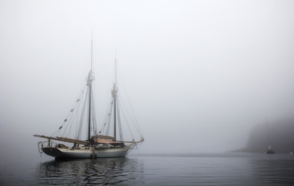 The schooner Mary Day sits at anchor in the morning fog off South Brooksville, Maine.