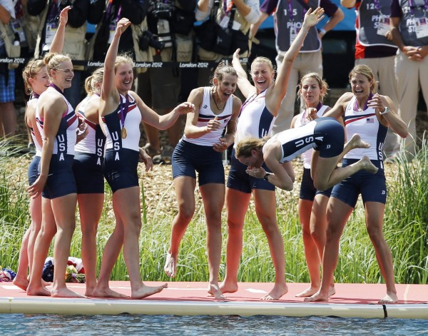 U.S. rowers Caryn Davies (from left), Caroline Lind, Eleanor Logan, Meghan Musnicki, Taylor Ritzel, Esther Lofgren, Zsuzsanna Francia and Erin Cafaro throw coxswain Mary Whipple into the water after winning the gold medal for the women's rowing eight in Eton Dorney, near Windsor, England, at the 2012 Summer Olympics, Thursday, Aug. 2, 2012.