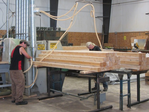 Workers at CedarWorks manufacturing plant in Rockland's Industrial Plant sand the cedar lumber.