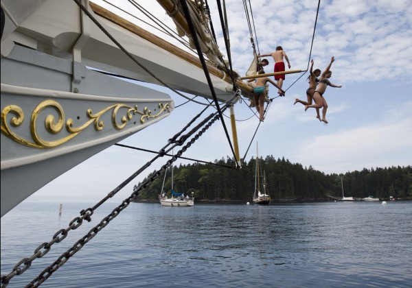 Olivia Trankina of Marietta, Ga., and Liz Archibald of Clarks Summit, Penn., leap from the bowsprit of the schooner Mary Day in Bucks Harbor in South Brooksville, Maine.