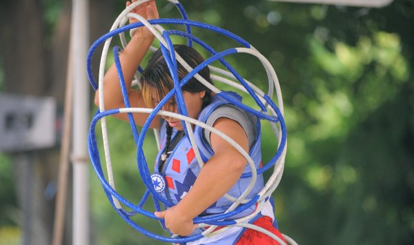 Star Chief Eagle performs a traditional hoop dance at the Two Rivers Stage during the American Folk Festival in Bangor on Saturday, Aug. 25, 2012. The Star and her father Dalls from South Dakota perform the ancient dance of the Lakota people.