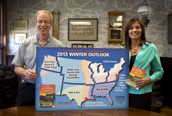 Farmers' Almanac publisher Peter Geiger (left) and editor Sondra Duncan pose in Lewiston on Thursday, Aug. 23, 2012, with a map showing the predicted weather forecast for the United States. In an election year, the almanac dubs its forecast &quota nation divided&quot because there's a dividing line where winter returns for much of the east, with milder weather west of the Great Lakes.