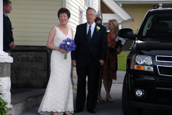 U.S. Sen. Susan Collins smiles as she stands with her husband, Thomas A. Daffron, outside Gray Memorial United Methodist Church in Caribou shortly after they were married on Saturday, Aug. 11, 2012.