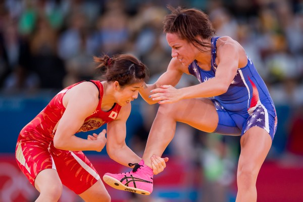 Japan's Saori Yoshida, left, grabbed the ankle of Kelsey Campbell of the United States, right, during women's 55kg freestyle wrestling action during the 2012 Summer Olympic Games in London. Yoshida won the match 3-0.