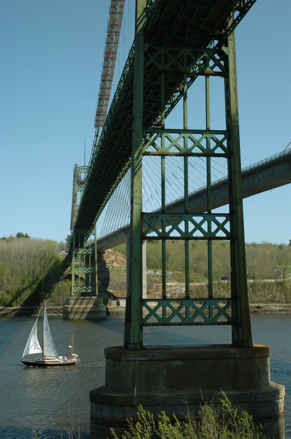 The Fleana, a 38-foot yawl, sails under the Penobscot Narrows Bridge and the old Waldo-Hancock County bridge Monday, May 14, 2007 on its way to Bangor after returning from Ireland.