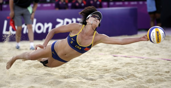 Zhang Xi of China goes for a dig during the women's Bronze Medal beach volleyball match against Brazil at the 2012 Summer Olympics, Wednesday, Aug. 8.