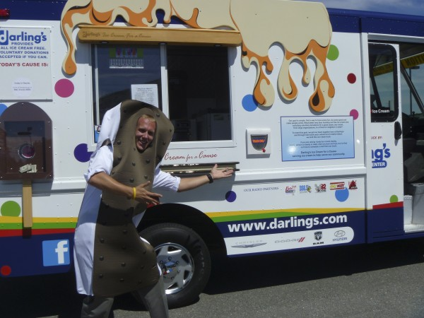 Bryan Lackee of Bangor, an employee of Darling's, hams is up as &quotIce Cream Man.&quot He volunteers time with Darling's Ice Cream for a Cause van.
