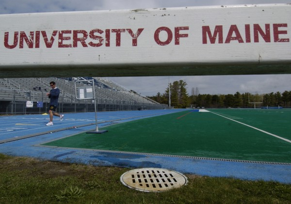 University of Maine senior Andy Hvizd of Wallingford, Conn., finishes up a run on the track around Morse Field Monday morning, May 5, 2008. The AstroTurf at the field was torn up in 2008 to install new Fieldturf synthetic surface, part of a multifield project costing about $3 million.