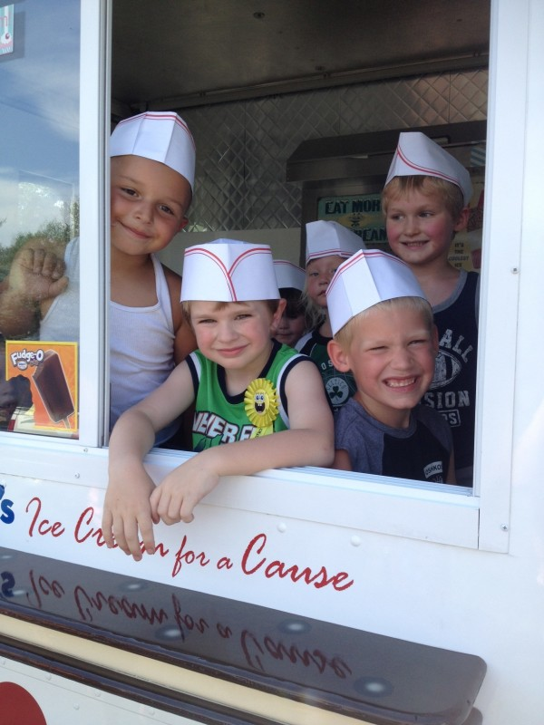 Birthday boy Brandon Bouchard of Hermon (center) and his pals (from left) Carter Cyr of Hermon, Alex Jones of Medway and Derek Couture of Waterville raised $60 recently for the Maine Discovery Museum at Brandon's party through Darling's Ice Cream for a Cause van.