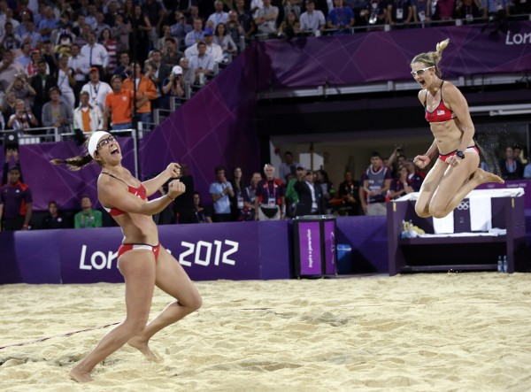 Misty May Treanor, left, and Kerri Walsh Jennings celebrate a win over April Ross and Jennifer Kessy during the women's Gold Medal beach volleyball match between two United States teams  at the 2012 Summer Olympics, Wednesday, Aug.