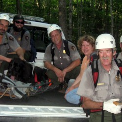After this Newfoundland collapsed from heat exhaustion Saturday afternoon, Aug. 5, 2012, while hiking an Acadia National Park mountain trail with his Canadian owners, this team of 10 rescuers carried Oolum down the mountain and transported him to a Bar Harbor vet clinic.