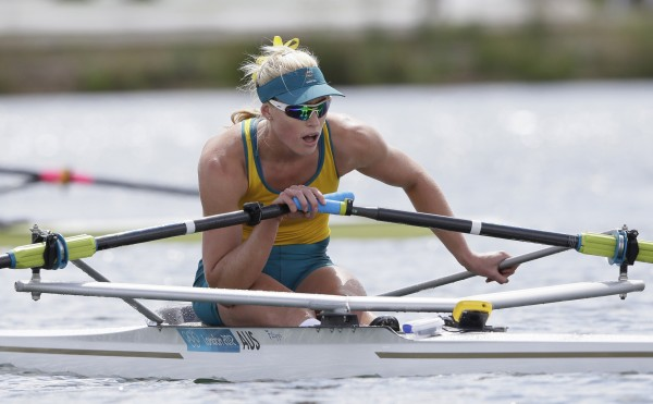 Australia's Kim Crow recovers after winning the bronze medal for the women's rowing single sculls in Eton Dorney, near Windsor, England, at the 2012 Summer Olympics, Saturday, Aug. 4.