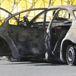 Burning-car deaths ruled triple homicide; police continue to seek man who walked away