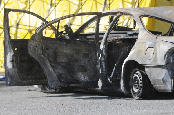 Police are calling the deaths of three people found inside this burning car a homicide.