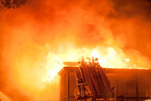 Firefighters battle an early morning fire Wednesday, Aug. 15, 2012 at 554 Main Street in South Portland.