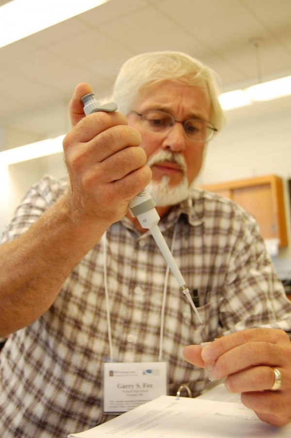 Portland High School biology teacher Garry Fox extracts a DNA sample during a genomics workshop at SMCC last week.