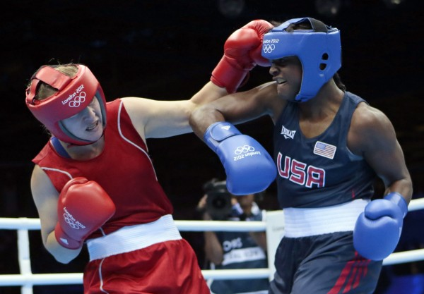 Kazakhstan's Marina Volnova, left, fights United States' Claressa Shields during their middleweight 75-kg semifinal boxing match at the 2012 Summer Olympics, Wednesday, Aug. 8.