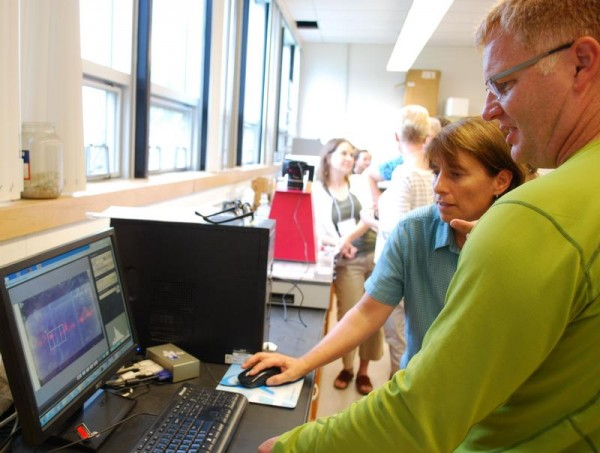 SMCC instructor Elizabeth Ehrenfeld and Bruce Nash of the DNA Learning Center at Cold Spring Harbor Laboratories view DNA strains Friday, Aug. 10, 2012, during a workshop at the college.