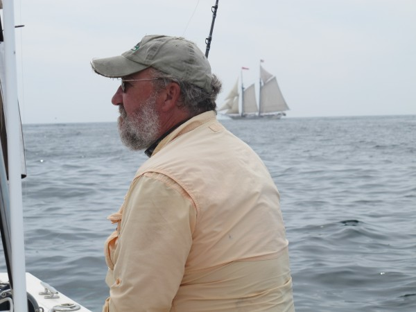 Pete Douvarjo of Eggemoggin Guide Service scans the horizon for sharks as a windjammer sails past near Mount Desert Rock on Tuesday, July 31, 2012.