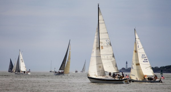 Boats tack back and forth toward Portland Headlight on Saturday Aug. 18, 2012, at the start of the MS Harborfest Regatta.