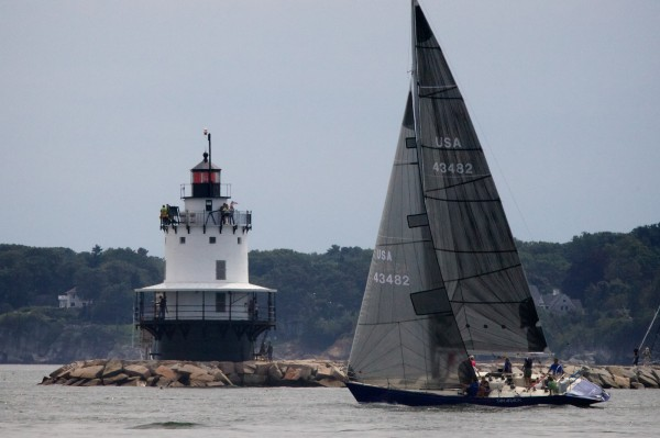 The Tamarack sails past Spring Point Ledge Light in South Portland on Saturday Aug. 18, 2012, at the start of the MS Harborfest Regatta.