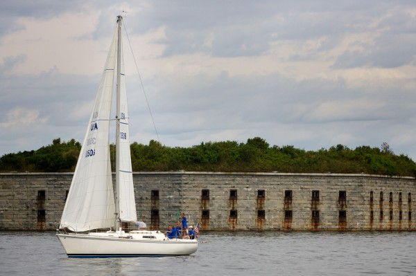 A boat lingers near Fort Gorges in Portland Harbor on Saturday Aug. 18, 2012, just before the start of the MS Harborfest Regatta.