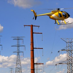 Helicopter used to install CMP towers for power lines across Penobscot