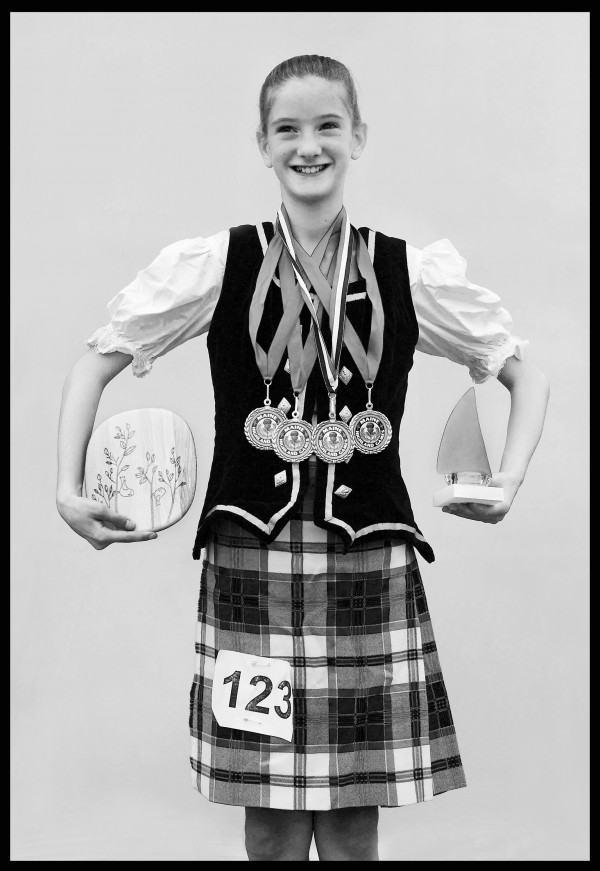 Scottish dancer Rachel Gow shows off her two trophies and four first-place medals. The 12-year-old from Worcester, Mass., was named most promising dancer.