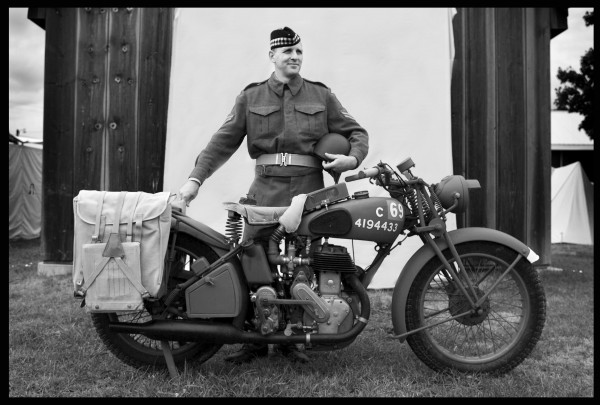 Sam Cormier of Ellsworth, portraying a dispatch rider for the World War II North Nova Scotia Highlanders, poses with his 1940 Norton War Dept. model 16H. Cormier restored the bike after having it shipped from England seven years ago.