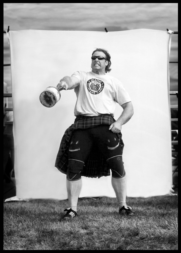 World record holder Mike Zolkiewicz demonstrates the technique he uses in the &quotweight over the bar&quot competition at the Highland Games. He tucks his kilt out of the way before swinging the 56-pound weight with one hand. No Scotsman has ever thrown the weight as high as this Pole from Springfield, Mass., who once tossed the weight 18 feet and 11 inches high.