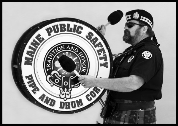 Kevin Dowling of Woolwich plays the 35-pound bass drum for the Maine Public Safety Pipe and Drum Corps. The high school guidance counselor plays regularly in the marching band, often performing at military funerals and parades.