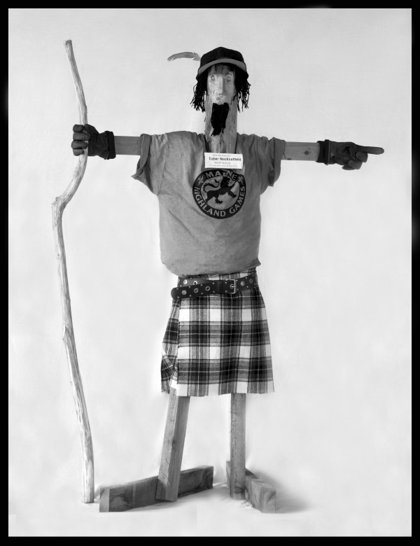 Caber MacKnotheid points the way for visitors eager to learn about their Scottish family tree at the Highland Games in Topsham.