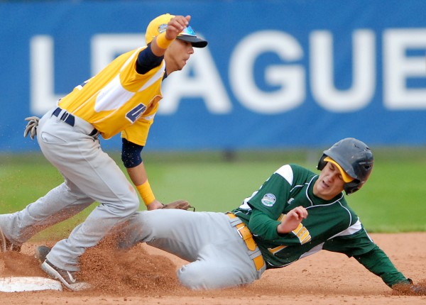 Latin America's Guillermo Saenz is out at second by U.S. West shortstop Esteban Lieras in the 3rd inning of the Senior Little League World Series championship game on Saturday. Latin America won the game 6-3.