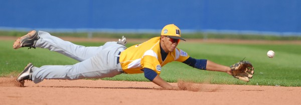 U.S West shortstop Alex Estrada misses a diving catch in the 6th inning of the Senior League World Series championship game against Latin America on Saturday.