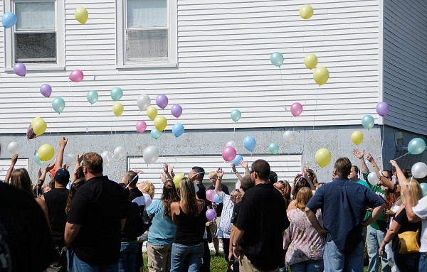 Friends and family of Lucas A. Tuscano release balloons into the air following the memorial service for him at Charleston Town Hall on Saturday afternoon, Aug. 25, 2012.