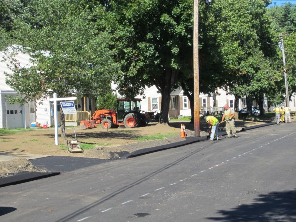 Crews from Lewiston-based TW Paving finish curbs on Emanual Street in the McKeen Street housing complex in Brunswick in early August.