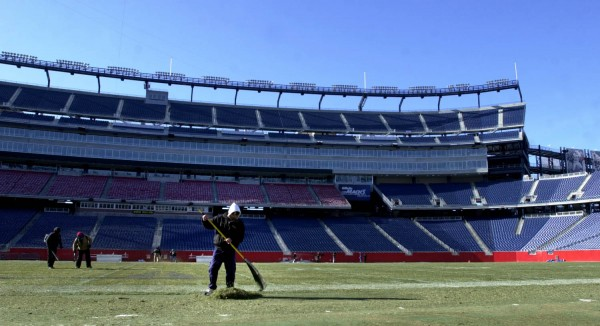 Gillette Stadium workers rake the field in January 2004.