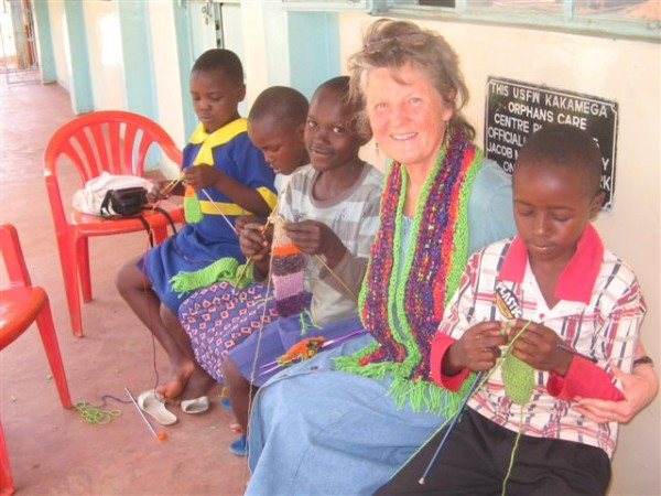 During a recent trip to Africa, Sharon Salmon of Liberty helps students learn to knit at the Kakamega Care Centre for children orphaned by AIDS in Kenya.