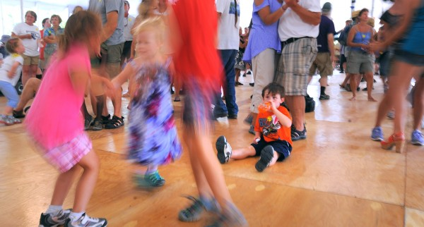 People of all ages dance to the music of D.L. Menard & Friends at the Dance Pavilion during the 2012 American Folk Festival in Bangor on Saturday, Aug. 25, 2012.