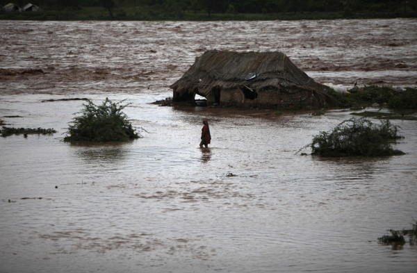An Indian woman wades through the banks of the River Tawi, which is flooded due to monsoon rains, in Jammu, India, on Sunday, Aug. 19, 2012. Monsoon rains usually hit India from June to September.
