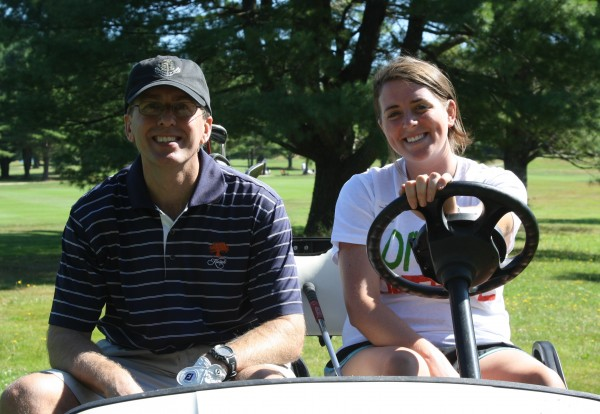 Golfer Jim Carroll and caddy Amy Lowitt recorded 109 holes during a past Camp Agawam Golf Marathon in Raymond.