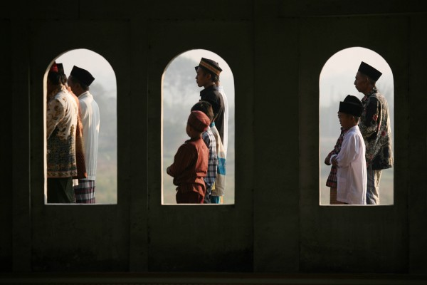 Indonesian Muslims perform Eid al-Fitr prayers, which mark the end of the holy fasting month of Ramadan at a mosque in Porong, East Java, Indonesia, on Sunday, Aug. 19, 2012.