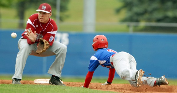 Canada's Eric Punski slides safely into second base by Maine's shortstop Matt Palmer in the 4th inning of the Senior Little League World Series opening game on Sunday afternoon at Mansfield Stadium.