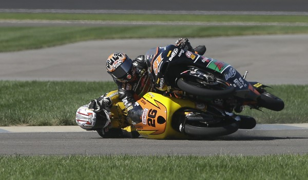 Adrian Martin (26) of Spain and Niklas Ajo of Finland crash on the opening lap of the Moto3 motorcycle race at the Indianapolis Motor Speedway in Indianapolis, Ind., on Sunday, Aug. 19, 2012.