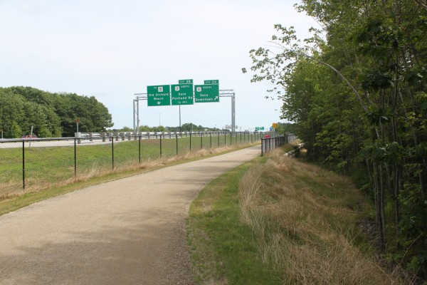 An off-road section of the East Coast Greenway, a route mapped out from the southern tip of Florida to Calais, Maine, runs beside the Interstate 195 in Saco on Aug. 14, 2012.