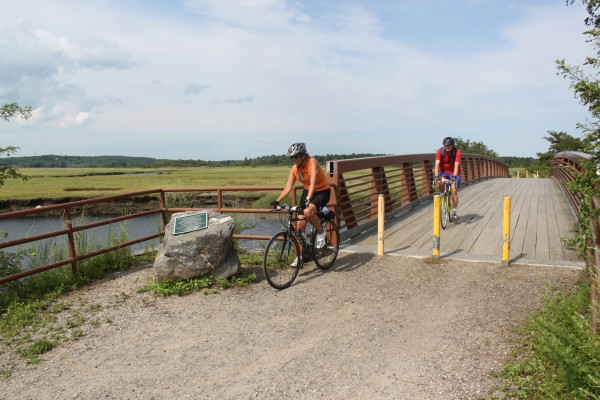 Marjorie Foote and Philip McGranahan of Kittery bike through Scarborough Marsh on Aug. 14, 2012, as they follow the East Coast Greenway from Portland to Saco.