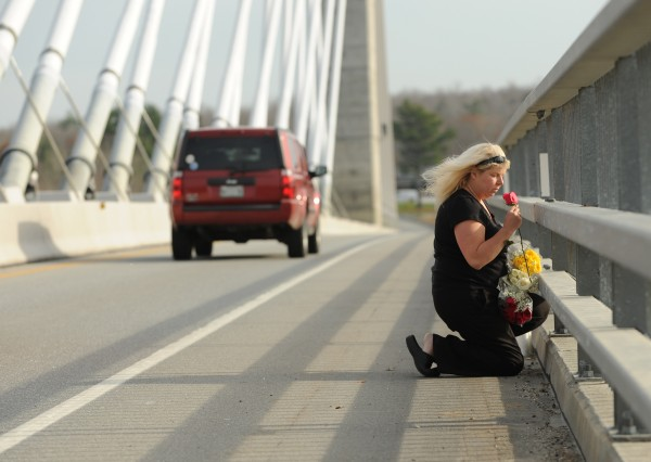&quotFor you there wil be no crying. For you the sun will be shining,&quot a woman who asked not to be identified said as she tossed flowers off the Penobscot Narrows Bridge on Monday, November 14, 2011. She was honoring the memory of the Rev. Robert Carlson, who jumped from the bridge on Sunday. She explained that Carlson had talked her out of jumping off the same bridge in June 2010. &quotI was supposed to be in the water.&quot she said.