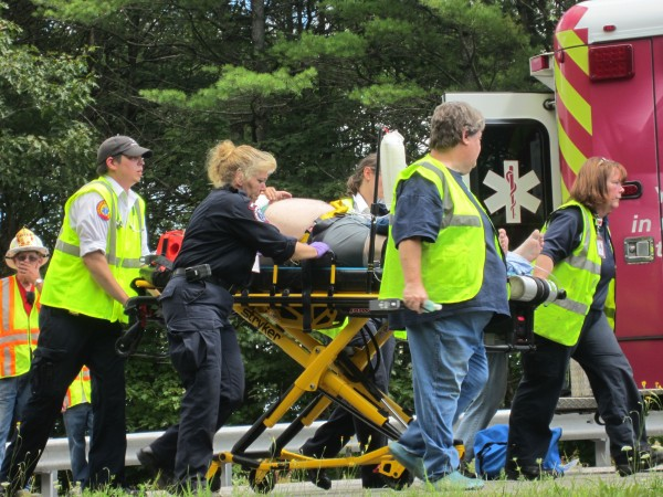 Larry Huff of Westbrook is taken to a LifeFlight helicopter after losing control of his van on Interstate 295 in Bowdoinham on Tuesday.